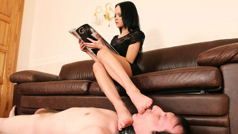 Reading a lady put her bare feet on a boy