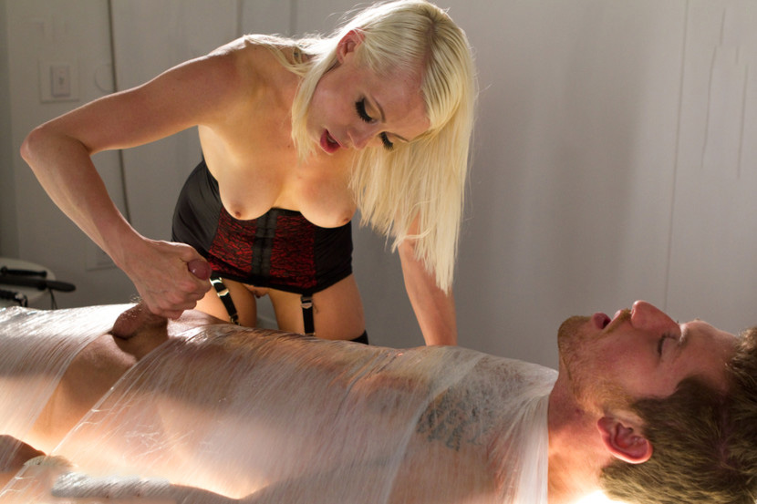Mistress wires up slaves cock and electrifies his dick