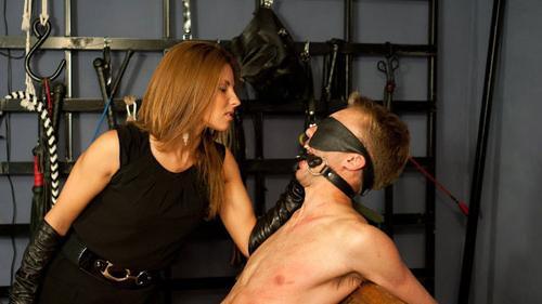 Mistress in fishnet smothers and dominates using foot